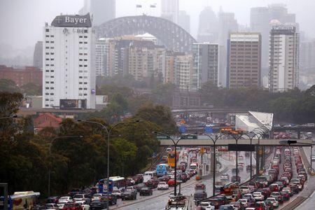 Cars and buses sit on a road that leads onto the Sydney Harbour Bridge as strong winds and floods cause traffic problems in Sydney, Australia, November 28, 2018.    REUTERS/David Gray
