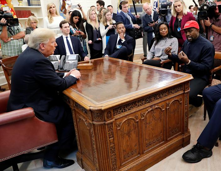 President Trump listens to rapper Kanye West during a meeting in the Oval Office, Oct. 11, 2018. (Kevin Lamarque/Reuters)