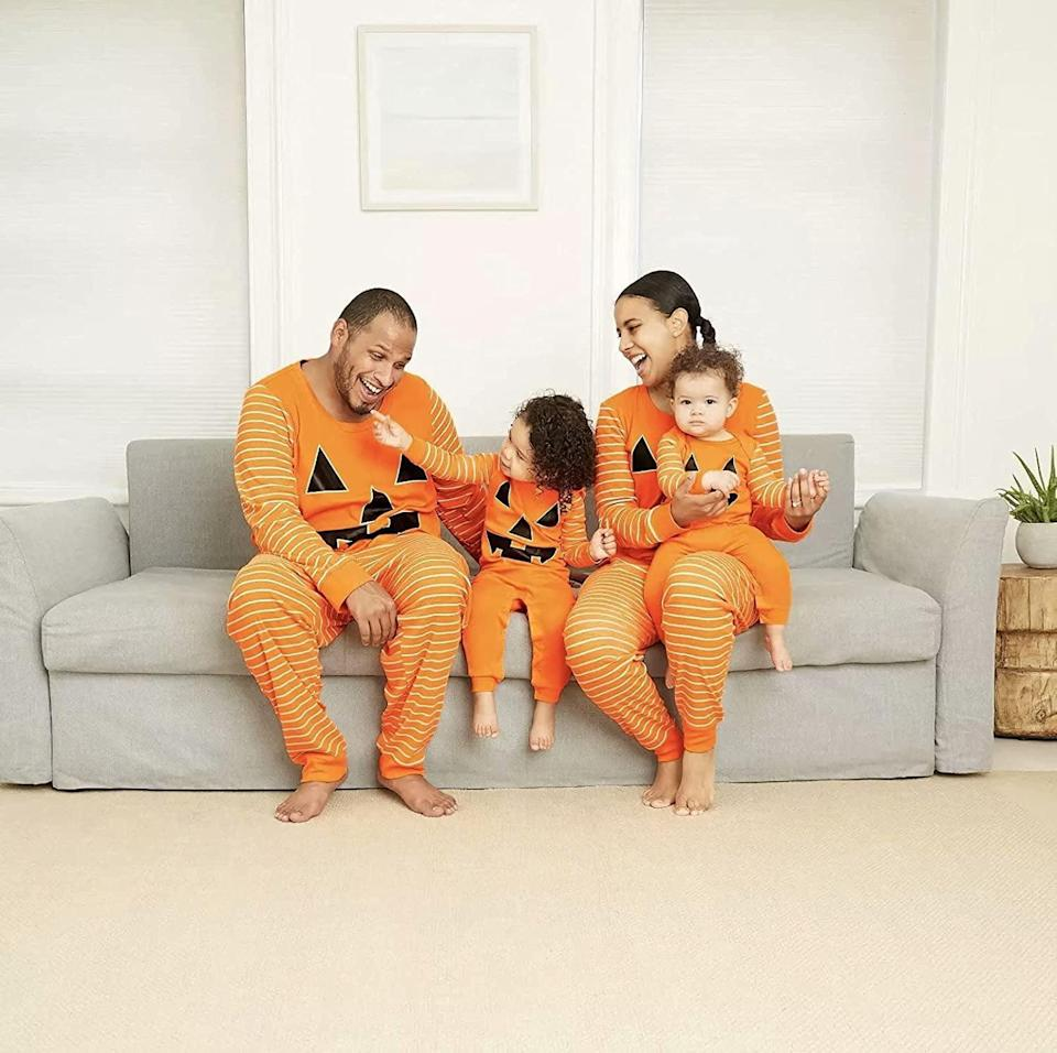 """<p>Transform the whole family into adorable jack-o-lanterns with these fun <span>Herimmy Family Matching Halloween Jack-O-Lantern Pajamas Set</span> ($20 - $50). The two-piece set is a must for those <a class=""""link rapid-noclick-resp"""" href=""""https://www.popsugar.com/Halloween"""" rel=""""nofollow noopener"""" target=""""_blank"""" data-ylk=""""slk:Halloween"""">Halloween</a> photoshoots. Just imagine, baking yummy pumpkin spice treats in these cozy finds! </p>"""