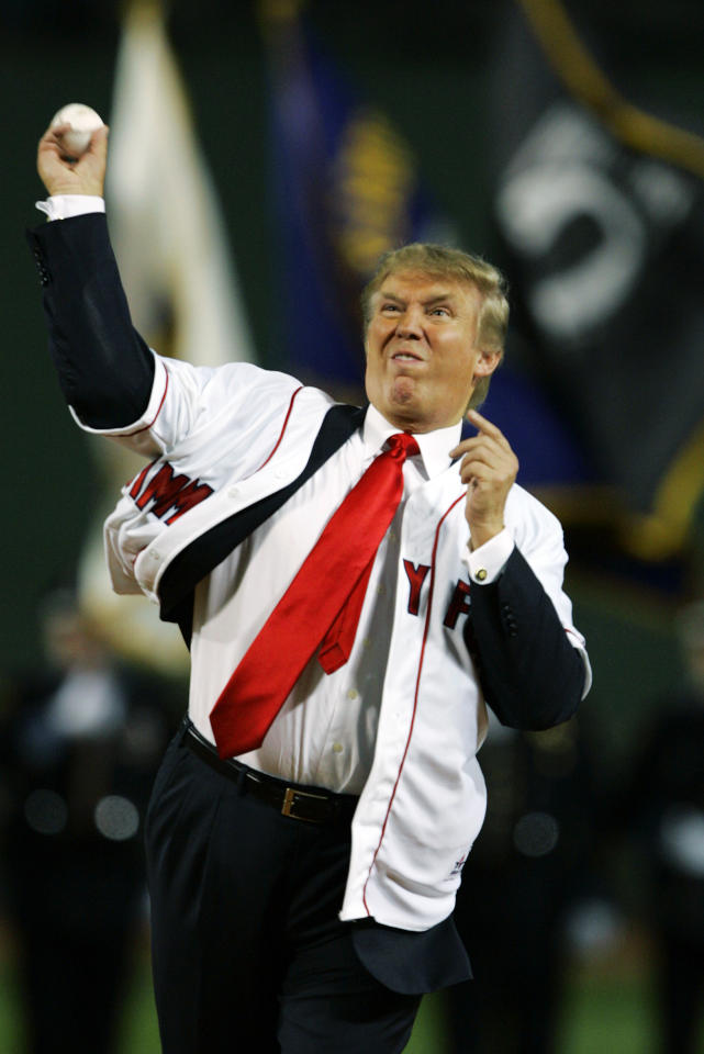 Donald Trump throws out the ceremonial first pitch before the start of the game between the Boston Red Sox and the New York Yankees  in the second game of a day/night doubleheader Friday, Aug.18, 2006, at Fenway Park in Boston. (AP Photo/Charles Krupa)