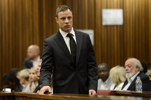 South African Paralympic athlete Oscar Pistorius arrives at the High Court in Pretoria on October 21, 2014 (AFP Photo/Herman Verwey)