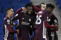 Leicester's Daniel Amartey, 2nd right, is congratulated by his teammates after scoring his side's second goal during the English Premier League soccer match between Brighton & Hove Albion and Leicester City at the AMEX Stadium in Brighton, England, Saturday, March 6, 2021. (Neil Hall/Pool via AP)