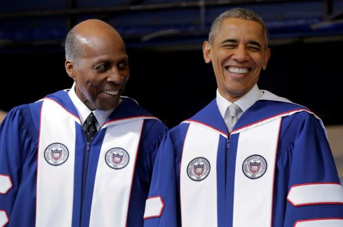 FILE PHOTO: U.S. President Barack Obama smiles as he speaks with Vernon Jordan before delivering the commencement address to the 2016 graduating class of Howard University in Washington
