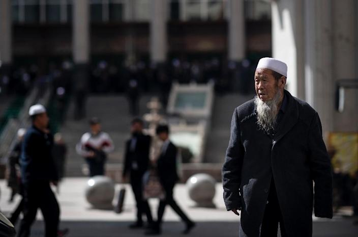 China is rolling out its newly revised Religious Affairs Regulations, which have intensified punishments for unsanctioned religious activities across all faiths and regions (AFP Photo/Johannes EISELE)