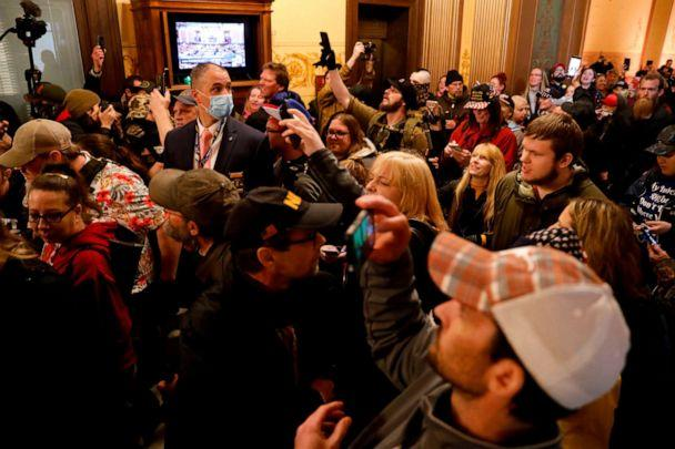 PHOTO: Protestors try to enter the Michigan House of Representative chamber after the American Patriot Rally organized by Michigan United for Liberty protest for the reopening of businesses in Lansing, Michigan, April 30, 2020. (Jeff Kowalsky/AFP via Getty Images)