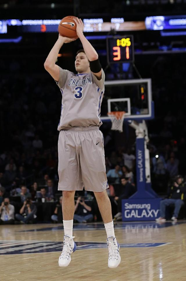 Creighton's Doug McDermott (3) shoots a 3-point basket during the first half of an NCAA college basketball game against DePaul in the quarterfinals of the Big East Conference tournament on Thursday, March 13, 2014, at Madison Square Garden in New York. (AP Photo/Frank Franklin II)
