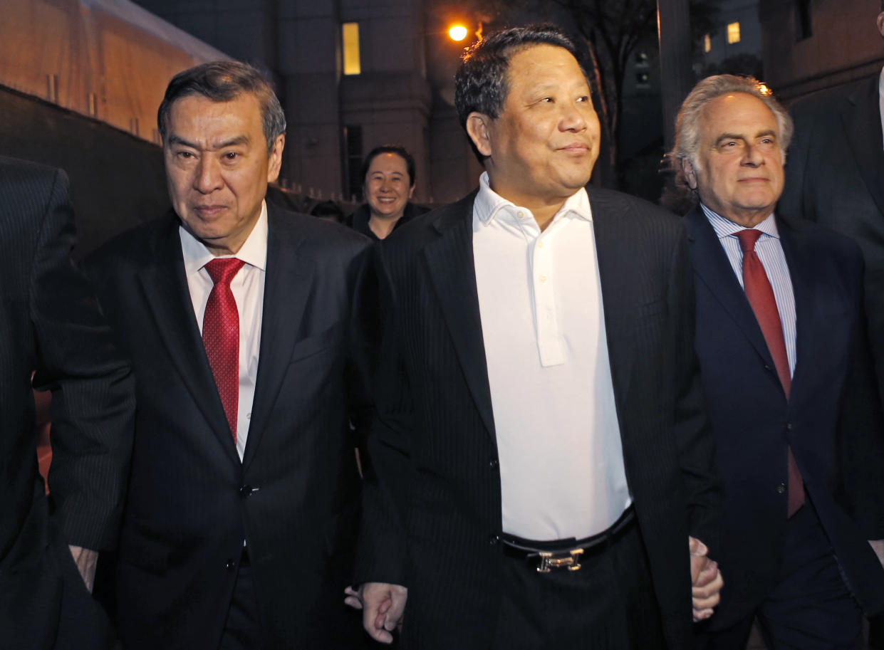 Chinese billionaire Ng Lap Seng, center, leaves federal court with his attorney Benjamin Brafman, right, after he was released on bail in connection with a United Nations bribery scheme in New York City on Oct. 26, 2015. (Photo: Kathy Willens/AP)