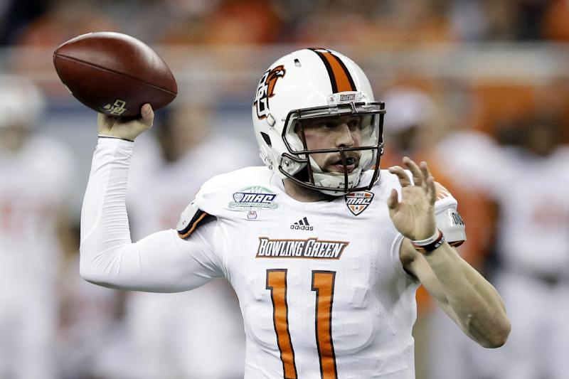 Bowling Green quarterback Matt Johnson throws during the first quarter of an NCAA college football game against Northern Illinois at the Mid-American Conference championship in Detroit, Friday, Dec. 6, 2013. (AP Photo/Carlos Osorio)