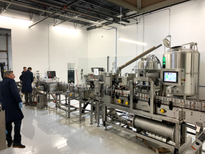 Cans of Fit Soda™ in its Orange Cream flavour being manufactured in the canning facility operated by Bevcreation, a subsidiary of the Company which is also based in the Denver, CO area