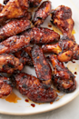 """<p>Get your marinating for the best wings of your life. The spicy sweet heat will keep you coming back for more. </p><p>Get the recipe from <a href=""""https://www.delish.com/cooking/recipe-ideas/a25920956/chicken-wing-marinade-recipe/"""" rel=""""nofollow noopener"""" target=""""_blank"""" data-ylk=""""slk:Delish"""" class=""""link rapid-noclick-resp"""">Delish</a>.</p>"""