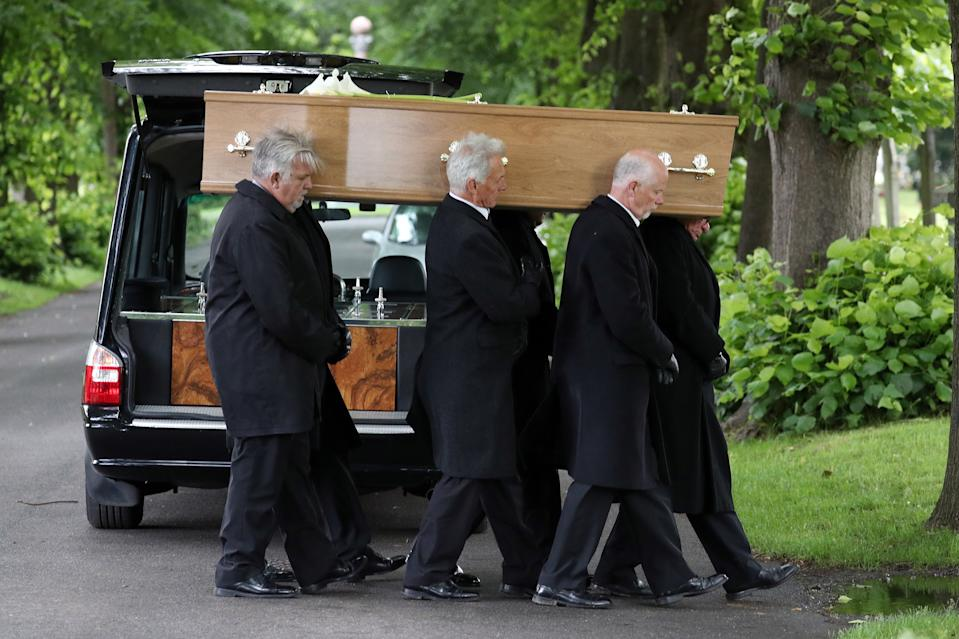 Pall-bearers carry the coffin of Jeremy Kyle guest Steve Dymond during his funeral at Kingston Cemetery in Portsmouth.