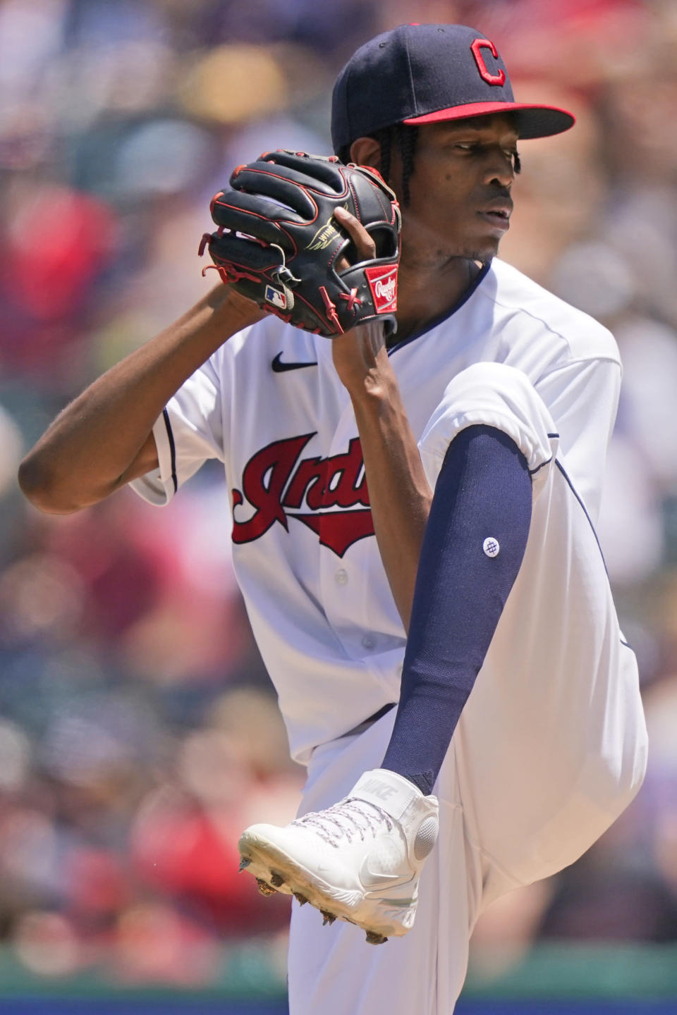 Cleveland Indians starting pitcher Triston McKenzie delivers in the first inning of a baseball game against the Tampa Bay Rays, Sunday, July 25, 2021, in Cleveland. (AP Photo/Tony Dejak)