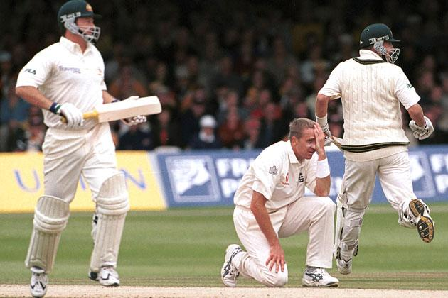 A dejected Dominic Cork of England as Mark Waugh and brother Steve Waugh of Australia clock up the runs during the second day of the Second Npower Test between Engalnd and Australia at Lord's, London.   Mandatory Credit: Craig Prentis/ALLSPORT