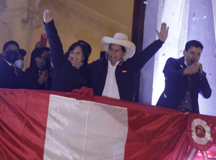 Pedro Castillo, center, celebrates with his running mate Dina Boluarte after being declared president-elect of Peru by election authorities, at his party´s campaign headquarters in Lima Peru, Monday, July 19, 2021. Castillo was declared president-elect more than a month after the elections took place and after opponent Keiko Fujimori claimed that the election was tainted by fraud. (AP Photo/Guadalupe Prado)