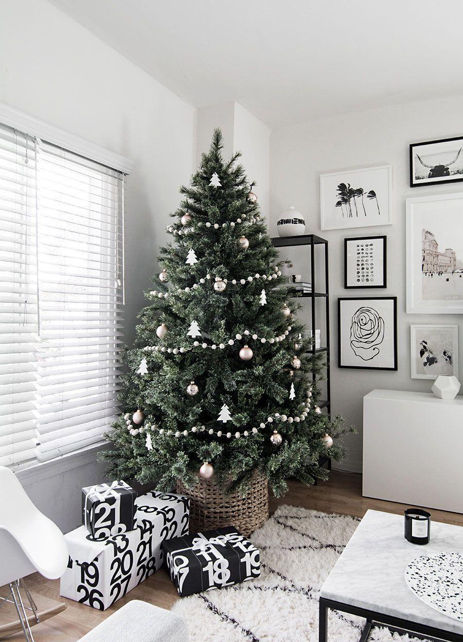 "<p>Go for a Scandinavian-style Christmas display this year. The minimalist aesthetic is totally gorgeous but still cozy for the holidays. </p><p>See more at <a href=""https://www.homeyohmy.com/minimal-scandinavian-christmas-tree/"" rel=""nofollow noopener"" target=""_blank"" data-ylk=""slk:Homey Oh My"" class=""link rapid-noclick-resp"">Homey Oh My</a>.</p><p><a class=""link rapid-noclick-resp"" href=""https://www.target.com/p/16-34-x14-5-34-decorative-basket-natural-threshold-8482/-/A-53790464?ref=tgt_adv_XS000000&AFID=google_pla_df&fndsrc=tgtao&CPNG=PLA_Storage%2BOrganization%2BShopping_Local&adgroup=SC_Storage%2BOrganization&LID=700000001170770pgs&network=g&device=c&location=9018721&ds_rl=1246978&ds_rl=1247068&ds_rl=1248099&gclid=CjwKCAjwsan5BRAOEiwALzomX664hMcWEhauXJq3t_Mtlmp1twd27zne5KriYOOLXsCMxOeI7oGnjBoCF7UQAvD_BwE&gclsrc=aw.ds"" rel=""nofollow noopener"" target=""_blank"" data-ylk=""slk:SHOP BASKETS"">SHOP BASKETS</a> <strong><em>Woven Basket, $27</em></strong></p>"