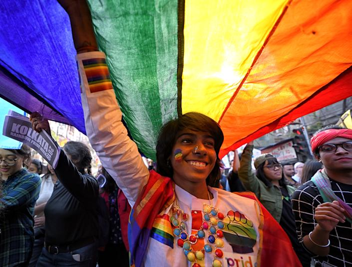 KOLKATA, INDIA - 2019/12/29: LGBT Community members hold a Rainbow flag during the Pride walk. Kolkata Rainbow Pride Walk (KRPW) is the oldest pride walk in India and South Asia started from 1992. The walk was organised to strengthen the voice for equality irrespective of gender, sexuality, religion, community, orientation. (Photo by Avishek Das/SOPA Images/LightRocket via Getty Images)