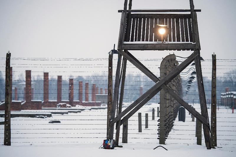 A watch tower stands along a barbed wire fence at the memorial site of the former Auschwitz-Birkenau concentration camp in Oswiecim, Poland (AFP Photo/Odd Andersen)