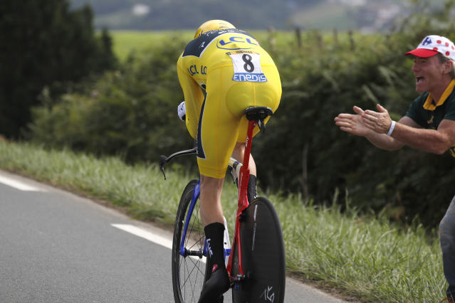 Britain's Geraint Thomas, wearing the overall leader's yellow jersey, rides during the twentieth stage of the Tour de France cycling race, an individual time trial over 31 kilometers (19.3 miles)with start in Saint-Pee-sur-Nivelle and finish in Espelette, France, Saturday July 28, 2018. (AP Photo/Peter Dejong)