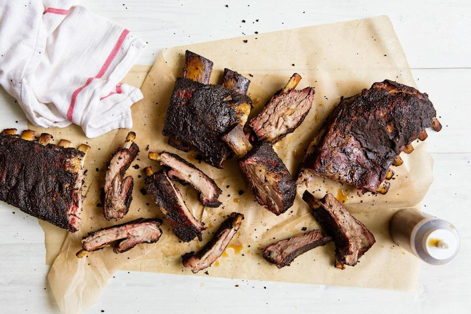 """Many smoked ribs recipes have you remove the membrane from the underside of the ribs before cooking them. I don't see the point, unless you're entering your ribs in a barbecue competition: it's a pain in the ass to remove and there's usually very little meat on that side of the ribs, plus I like the extra structure that the membrane gives the rack, which makes it easier to move it around. <a href=""""https://www.epicurious.com/recipes/food/views/all-purpose-barbecue-ribs-56389838?mbid=synd_yahoo_rss"""" rel=""""nofollow noopener"""" target=""""_blank"""" data-ylk=""""slk:See recipe."""" class=""""link rapid-noclick-resp"""">See recipe.</a>"""