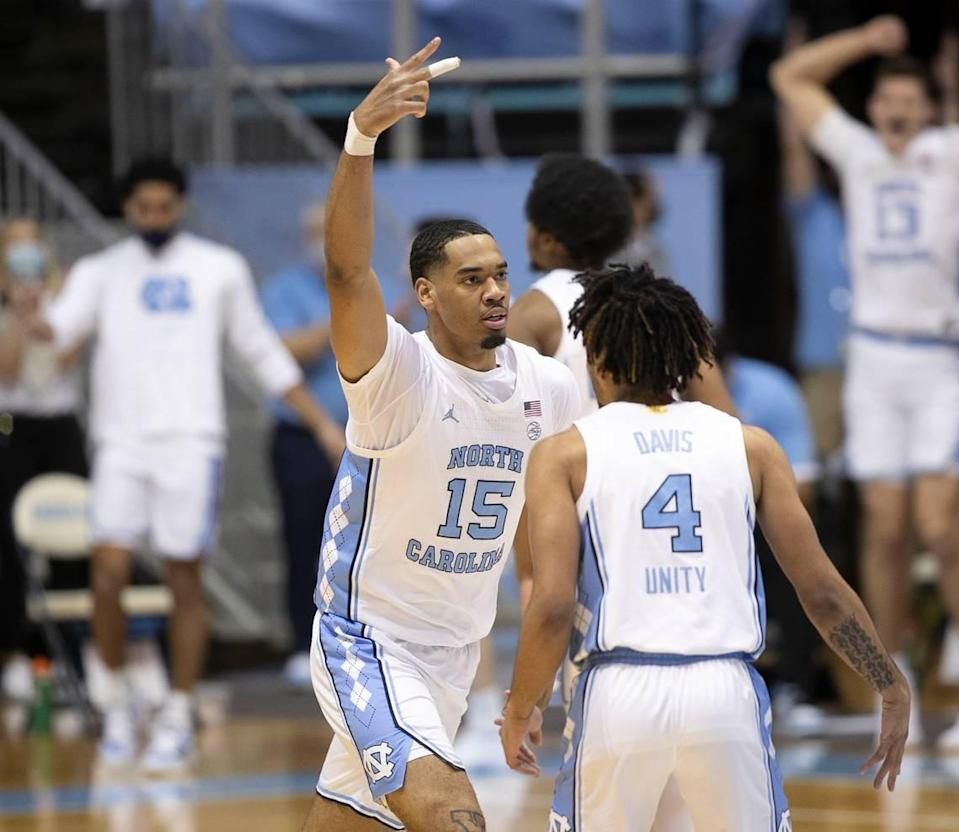 North Carolina's Garrison Brooks (15) reacts after sinking a three-point basket during the second half against Duke on Saturday, March 6, 2021 at the Smith Center in Chapel Hill, N.C.