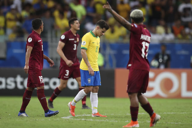 Brazil's Philippe Coutinho, center, reacts after his goal was annulled due to an offside position during a Copa America Group A soccer match against Venezuela at the Arena Fonte Nova in Salvador, Brazil, Tuesday, June 18, 2019. (AP Photo/Natacha Pisarenko)