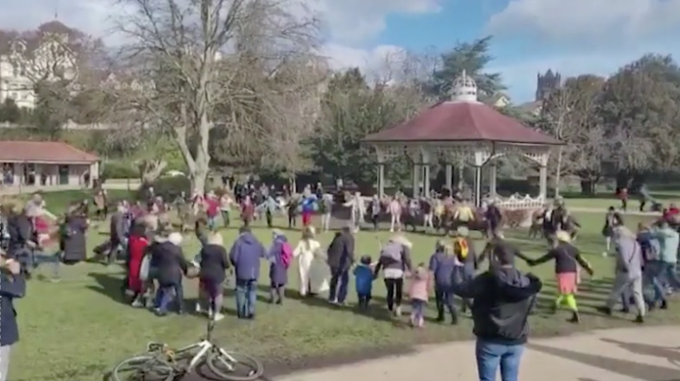 Footage captured the group signing and holding hands in a circle on an area of grass in Alexandra Park, Hastings on Saturday morning. (BBC Sussex)