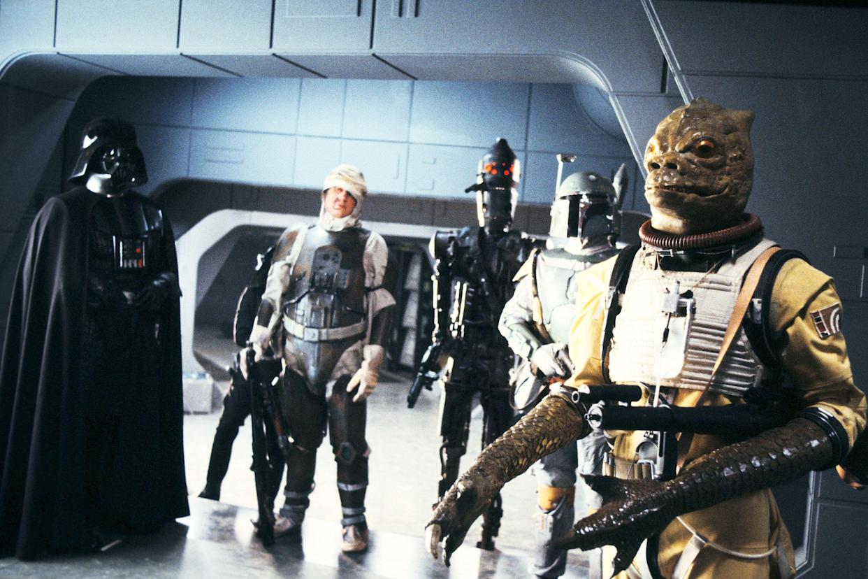 Darth Vader calls in the bounty hunters in <em>The Empire Strikes Back</em>: (from left to right) Dengar, IG-88, Boba Fett, and Bossk. (Photo: Lucasfilm)