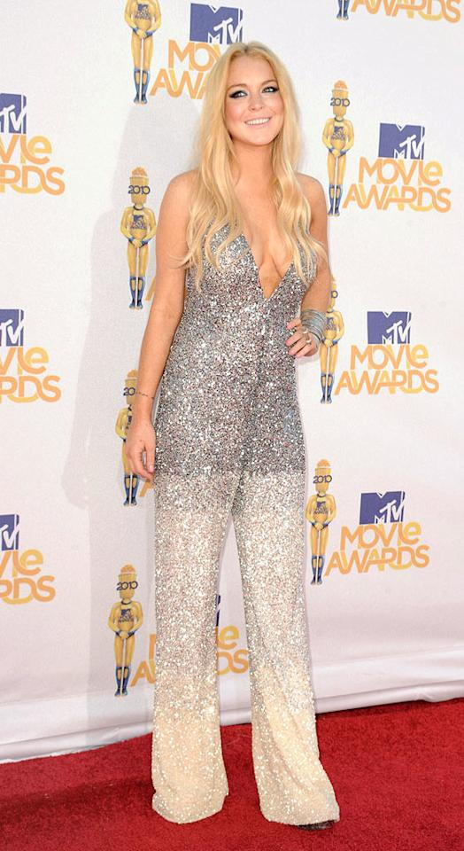"We know she's concerned about keeping her alcohol-monitoring ankle bracelet under wraps, but we simply can't forgive Lindsay Lohan for wearing this appalling Pamela Rolland jumpsuit to the 2010 MTV Movie Awards. The troubled star was undoubtedly the worst-dressed woman at the star-studded soiree. Steve Granitz/<a href=""http://www.wireimage.com"" target=""new"">WireImage.com</a> - June 6, 2010"