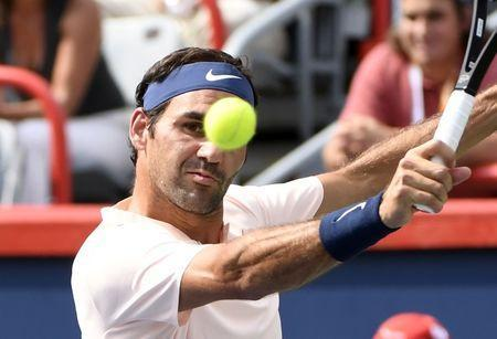 Aug 11, 2017; Montreal, Quebec, Canada; Roger Federer of Switzerland hits a backhand against Roberto Bautista Agut of Spain (not pictured) during the Rogers Cup tennis tournament at Uniprix Stadium. Mandatory Credit: Eric Bolte-USA TODAY Sports