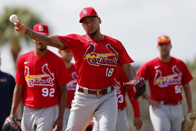 St. Louis Cardinals pitcher Carlos Martinez throws during a spring training baseball drill Wednesday, Feb. 12, 2020, in Jupiter, Fla. (AP Photo/Jeff Roberson)