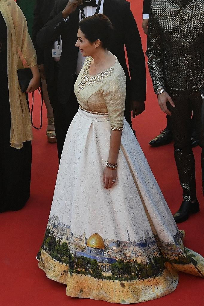 Israeli Culture Minister Miri Regev wears a dress featuring an image of the Al-Aqsa Mosque compound in Jerusalem, also known as the Temple Mount, as she attends a screening at the Cannes film festival on May 17, 2017 (AFP Photo/Antonin THUILLIER)