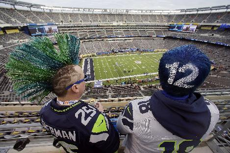 Seattle Seahawks fans John Hanshaw, left, and Pete Ford, both of Tacoma, Wash., watch the field before the NFL Super Bowl XLVIII football game between the Seattle Seahawks and the Denver Broncos, Sunday, Feb. 2, 2014, in East Rutherford, N.J
