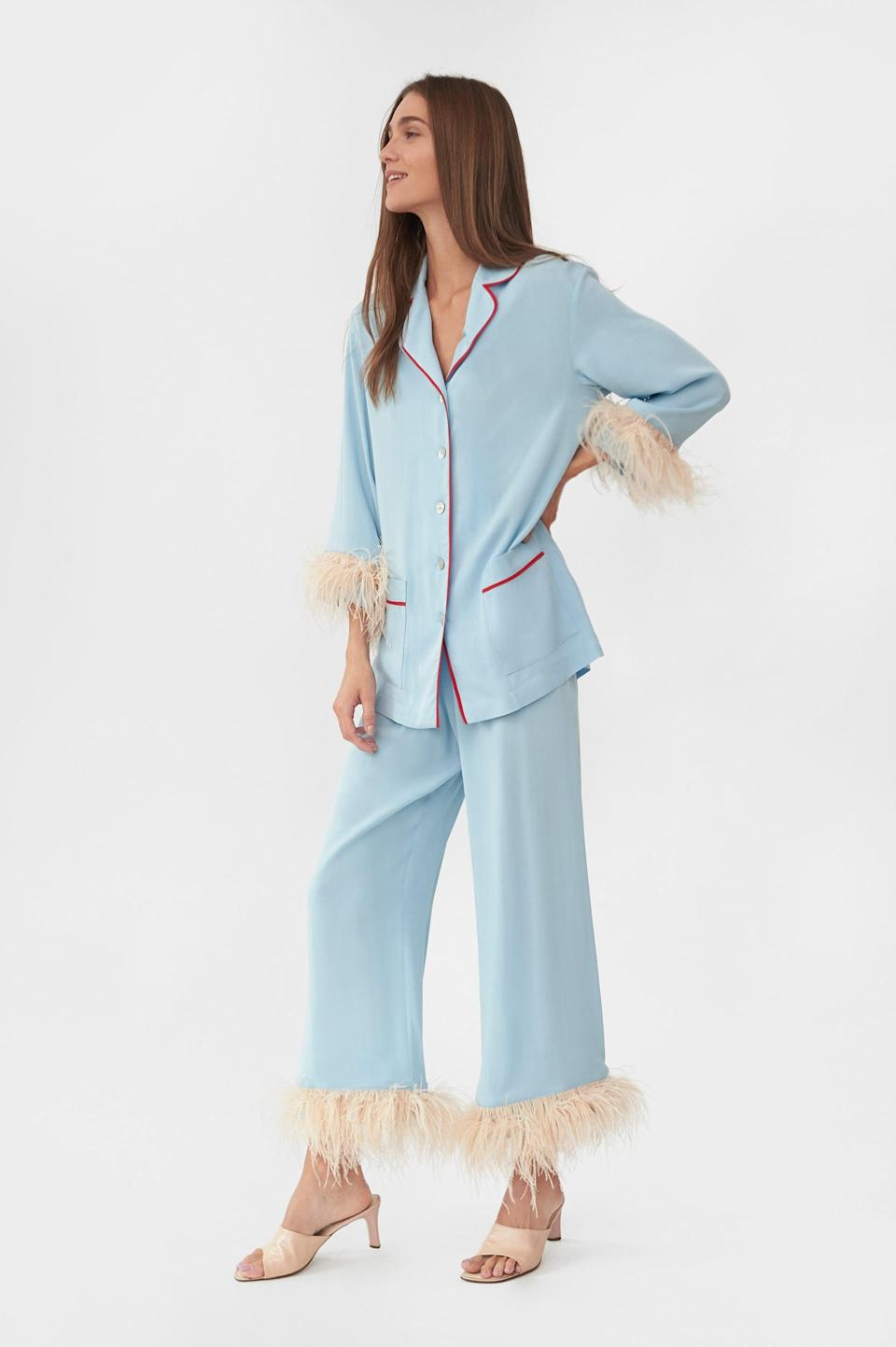 """<p><span>Sleeper Party Pajama Set with Feathers in Blue</span> ($320) </p> <p>""""These pretty pajamas aren't just sleepwear, they're a whole vibe."""" - HWM </p>"""