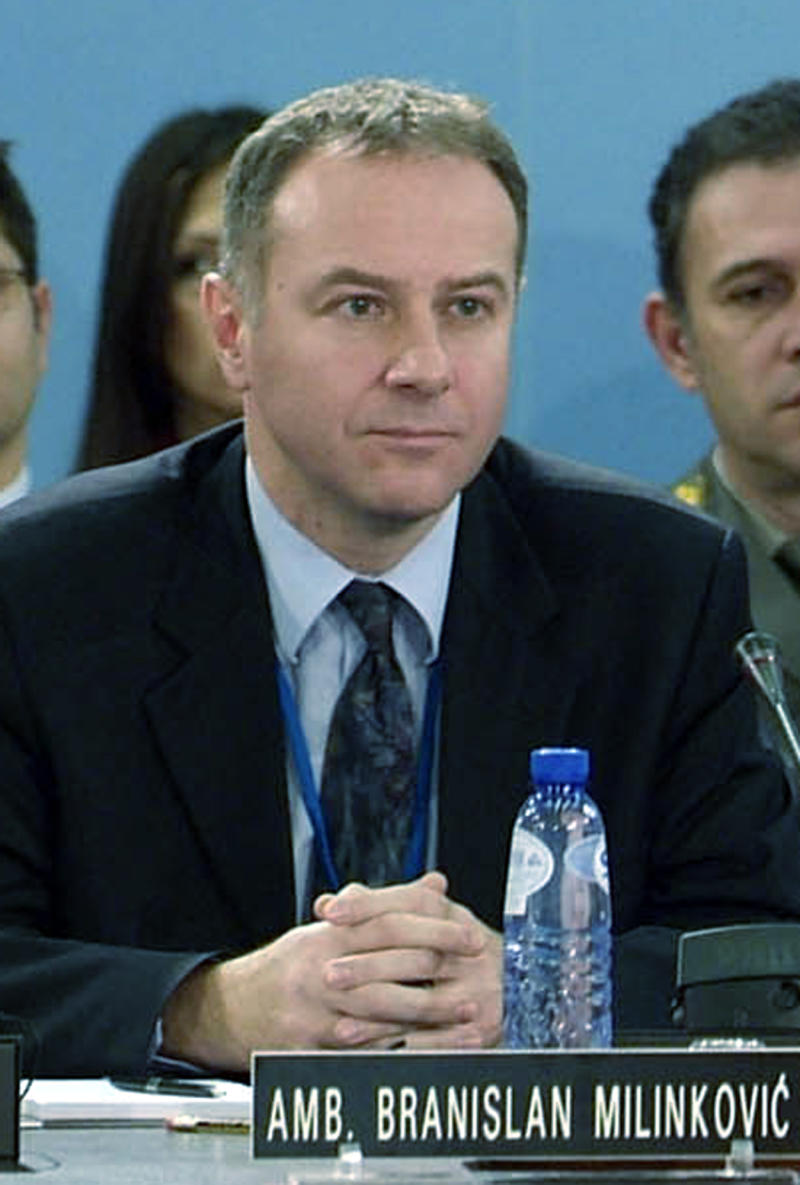 In this photo made available by NATO, in this Dec. 14, 2006 file photo, Serbia's Ambassador to NATO Branislav Milinkovic is seen during a meeting at NATO headquarters in Brussels, Belgium. A Serbian government statement said Wednesday Dec. 5, 2012,  that 52-year old Milinkovic committed suicide by leaping from a busy parking garage platform at Brussels Airport on Tuesday night.  A diplomat who could not be identified because he was not authorized to speak to the media said Milinkovic suddenly jumped from the 8- to 10-meter-high (26- to 33-foot-high) platform while waiting with the Serbian delegation for foreign ministry officials due to hold talks with NATO officials. (AP Photo/NATO, file)