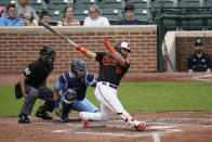 Baltimore Orioles' DJ Stewart follows through as he hits a solo home run off Toronto Blue Jays starting pitcher Alek Manoah during the fourth inning of a baseball game, Saturday, June 19, 2021, in Baltimore. (AP Photo/Julio Cortez)