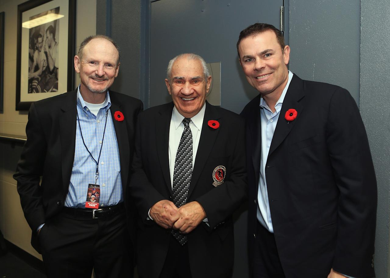 TORONTO, ON - NOVEMBER 11: (L-R) Barry Stafford, Jim Gregory of the Hall of Fame and Adam Oates, pose for a photo prior to the Hockey Hall of Fame Legends Game at the Air Canada Centre on November 11, 2012 in Toronto, Canada. Stafford, the long time trainer for the Edmonton Oilers will be honored along with Oates at the Hockey Hall of Fame induction ceremony at the Hall on November 12.  (Photo by Bruce Bennett/Getty Images)