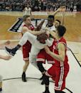 <p>Villanova forward Darryl Reynolds (45) grabs a rebound against Wisconsin guard Brevin Pritzl,left, guard Zak Showalter, center, and guard Bronson Koenig,right, during the first half of a second-round men's college basketball game in the NCAA Tournament, Saturday, March 18, 2017, in Buffalo, N.Y. (AP Photo/Bill Wippert) </p>