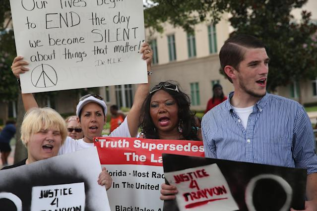 SANFORD, FL - JULY 13: Demonstrators protest in front of the Seminole County Criminal Justice Center where a jury is deliberating in the trial of George Zimmerman on July 13, 2013 in Sanford, Florida. Zimmerman, a neighborhood watch volunteer, is on trial for the February 2012 shooting death of 17-year-old Trayvon Martin. (Photo by Scott Olson/Getty Images)