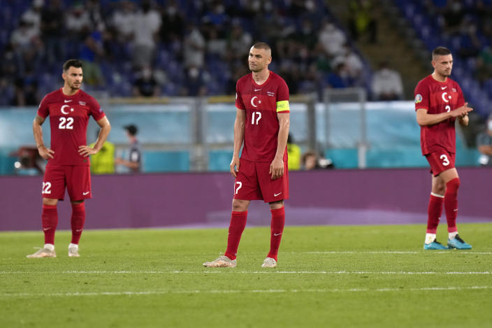 From left, Turkey's Kaan Ayhan, Burak Yilmaz and Merih Demiral react after Italy's Lorenzo Insigne scored his side's third goal, during the Euro 2020, soccer championship group A match between Italy and Turkey, at the Rome Olympic stadium, Friday, June 11, 2021. (AP Photo/Alessandra Tarantino, Pool)
