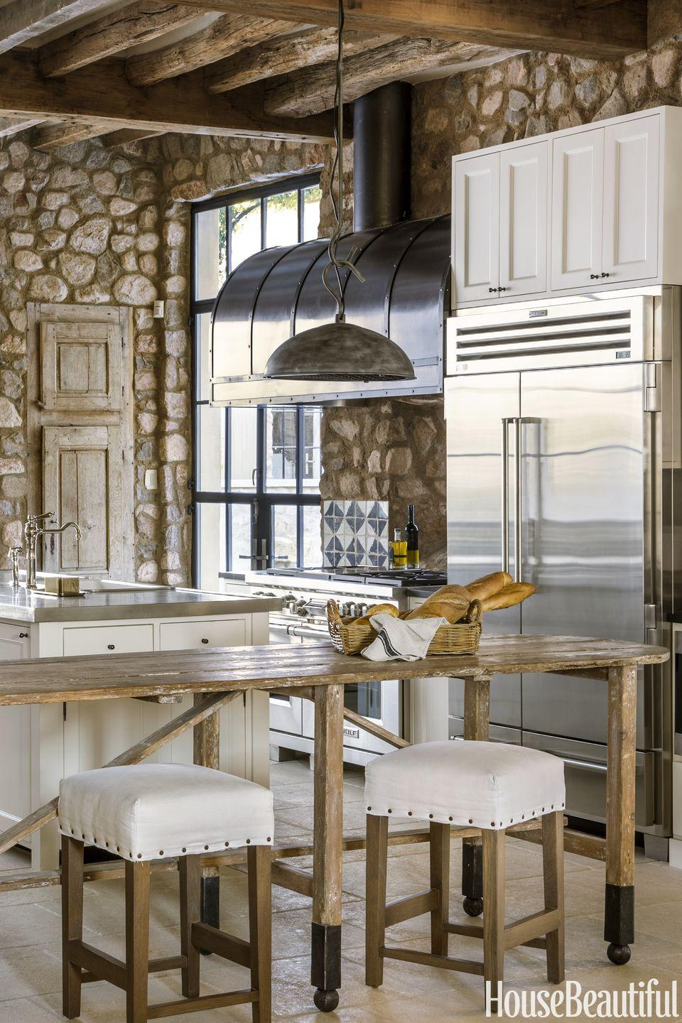 "<p>The contrast between the rustic stonework and streamlined stainless steel appliances give this <a href=""https://www.housebeautiful.com/room-decorating/kitchens/g13446033/inga-rehmann-scottsdale-kitchen/"" rel=""nofollow noopener"" target=""_blank"" data-ylk=""slk:French-inspired kitchen"" class=""link rapid-noclick-resp"">French-inspired kitchen</a> by Inga L. Rehmann a serious wow factor. To maximize entertaining space, downsize an island and add a trestle table with stools.</p>"