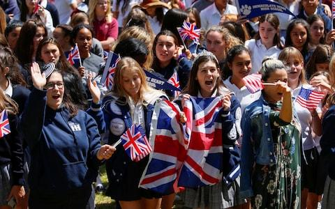Students and teachers at Meghan Markle's former Los Angeles high school stage a 'Here's to Meghan!' celebration ahead of her wedding  - Credit: MIKE BLAKE /Reuters