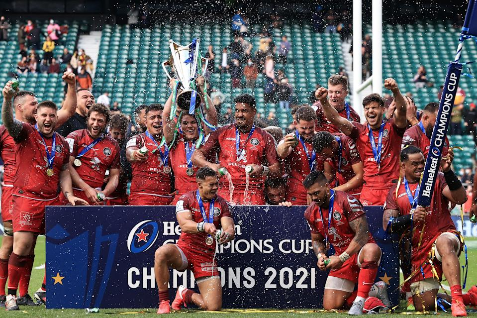<p>Toulouse's Antoine Dupont lifts the Heineken Champions Cup trophy at Twickenham</p> (Getty Images)