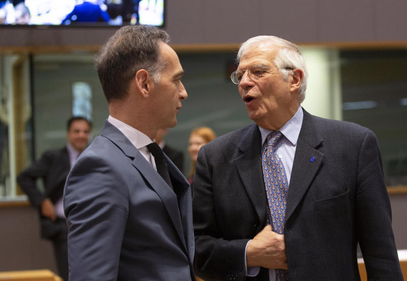 German Foreign Minister Heiko Maas, left, speaks with European Union foreign policy chief Josep Borrell during a meeting of EU foreign ministers at the Europa building in Brussels, Monday, Dec. 9, 2019. European Union foreign ministers are debating how to respond to a controversial deal between Turkey and Libya that could give Ankara access to a contested economic zone across the Mediterranean Sea. (AP Photo/Virginia Mayo)