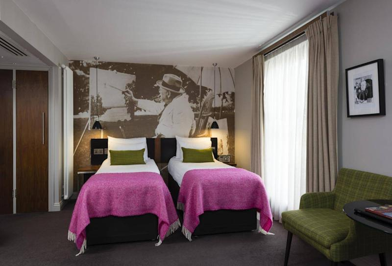 Hot pink bed sheets and a mural of you-know-who (The Churchill Hotel)