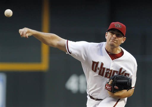 Arizona Diamondbacks' Daniel Hudson throws against the Oakland Athletics in the first inning of a baseball game Friday, June 8, 2012, in Phoenix. (AP Photo/Ross D. Franklin)