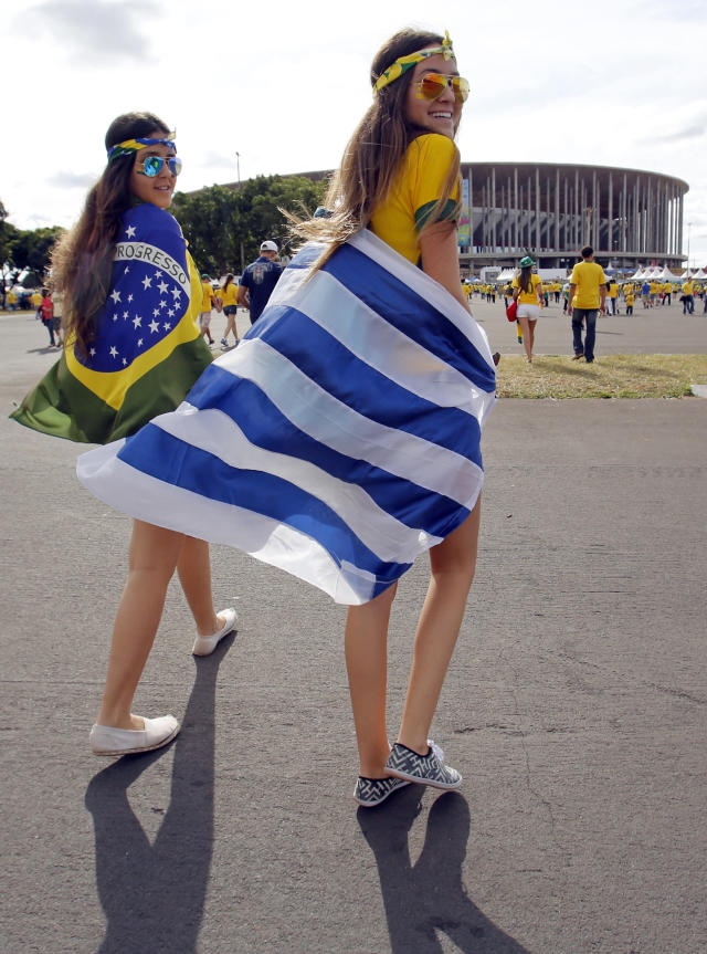 Soccer fans arrive for the group A World Cup soccer match between Cameroon and Brazil at the Estadio Nacional in Brasilia, Brazil, Monday, June 23, 2014. (AP Photo/Dolores Ochoa)
