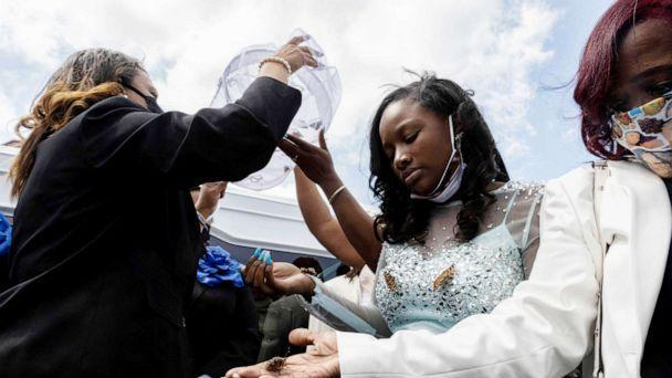 PHOTO: Ja'Niah Bryant releases butterflies into the air during funeral of her sister Ma'Khia Bryant in Columbus, Ohio, April 30, 2021. (Stephen Zenner/AFP via Getty Images)
