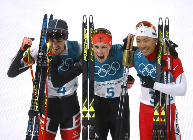 Nordic Combined Events - Pyeongchang 2018 Winter Olympics - Men's Individual 10km Final - Alpensia Cross-Country Skiing Centre - Pyeongchang, South Korea - February 14, 2018. Gold medalist Eric Frenzel of Germany, silver medalist Akito Watabe of Japan and bronze medalist Lukas Klapfer of Austria celebrate. REUTERS/Kai Pfaffenbach