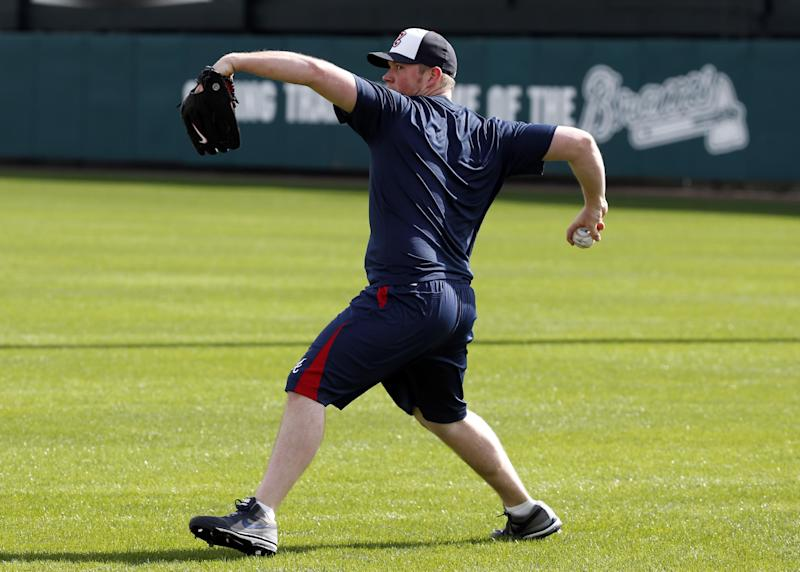 Atlanta Braves relief pitcher Craig Kimbrel throws during a spring training baseball workout, Thursday, Feb. 13, 2014, in Kissimmee, Fla. (AP Photo/Alex Brandon)