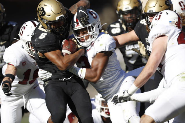 Stanford safety Malik Antoine, center right, tackles Colorado running back Alex Fontenot after a short gain in the first half of an NCAA college football game Saturday, Nov. 9, 2019, in Boulder, Colo. (AP Photo/David Zalubowski)
